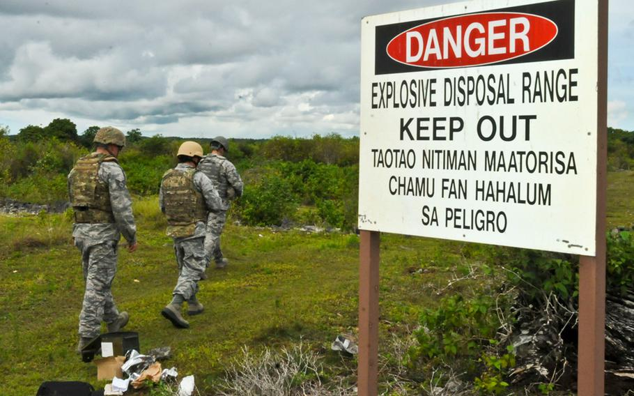 Airmen with engineering and ordnance explosion units train with ground burst simulators on a range at Andersen Air Force Base, Guam, Aug. 26, 2013.