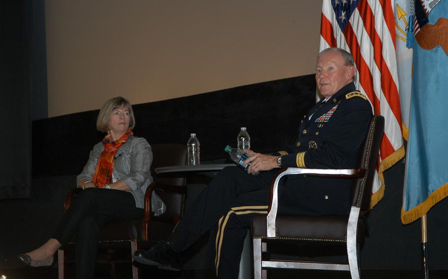 Gen. Martin Dempsey, chairman of the Joint Chiefs of Staff, and his wife, Deanie, spoke at a town hall-style meeting with about 300 servicemembers and their spouses at Yongsan Garrison in South Korea on Tuesday, Oct. 1, 2013. Dempsey answered a wide array of questions during the hour-long meeting.