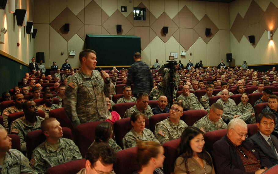 A soldier asks a question during a town hall-style meeting on Tuesday, Oct. 1, 2013, at Yongsan Garrison in South Korea led by Gen. Martin Dempsey, chairman of the Joint Chiefs of Staff, and his wife Deanie.