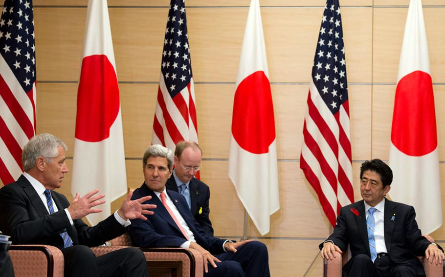 U.S. Defense Secretary Chuck Hagel (from left), U.S. Secretary of State John F. Kerry and Japanese Prime Minister Shinzo Abe meet at the prime minister's residence in Tokyo, Oct. 3, 2013.