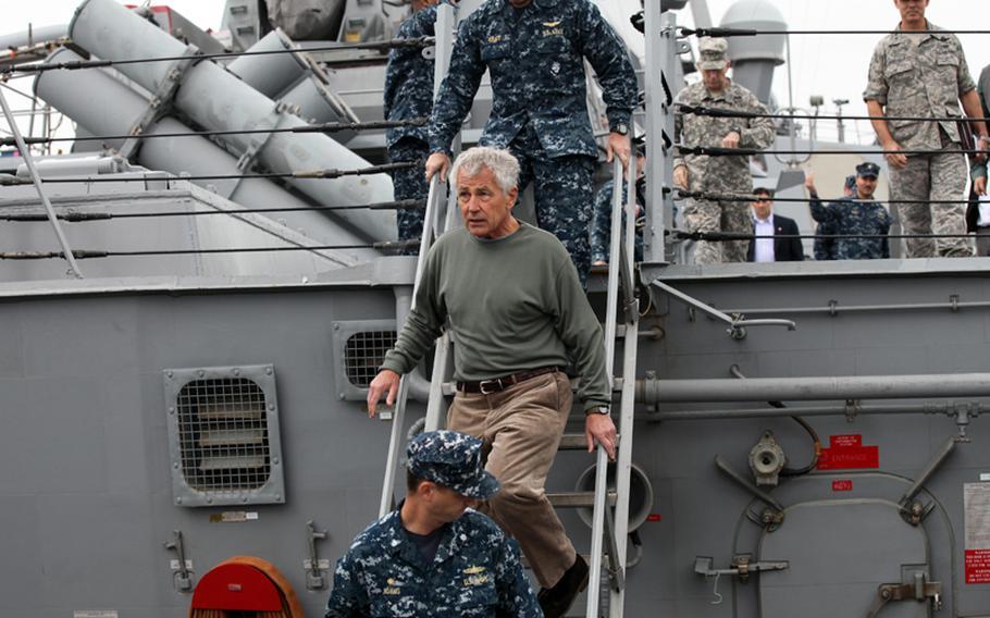 Defense Secretary Chuck Hagel visits the USS Stethem in Yokosuka, Japan, on Oct. 4, 2013. He spoke to sailors about the government shutdown.