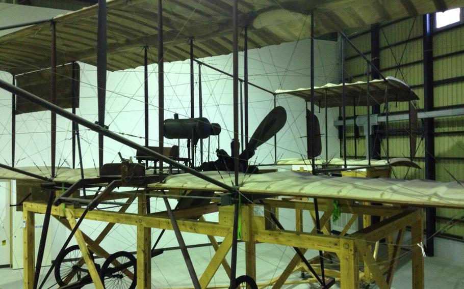 The Henry Farman biplane is Japan's Wright Flyer, the first plane to fly above the country. It is housed in a hangar behind Shubudai Memorial Hall on Iruma Air Base, Japan, Oct. 10, 2013.