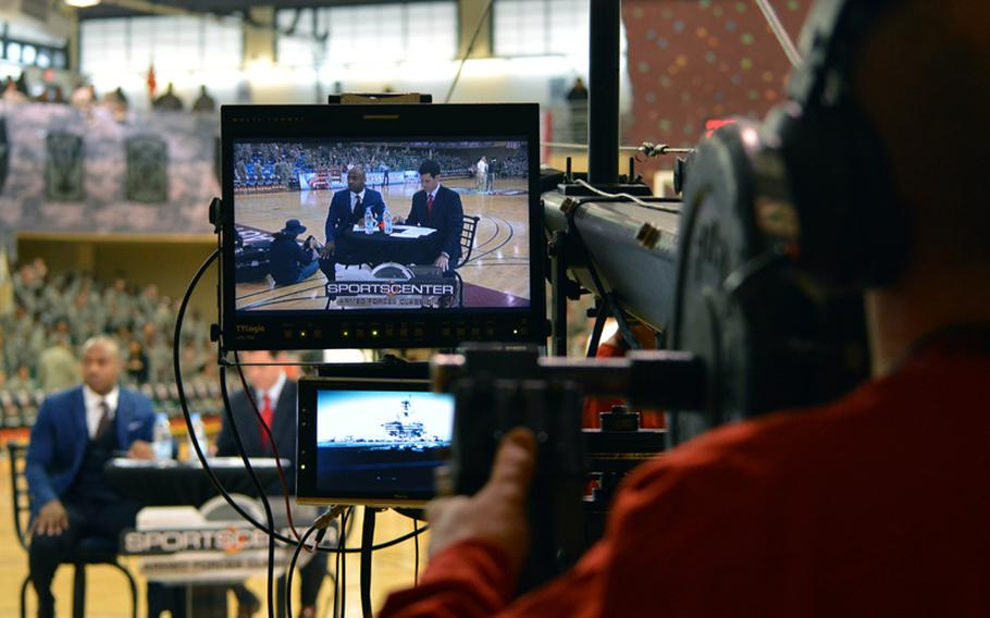 An ESPN cameraman takes a shot at the network's announcers at the Camp Humphreys Community Fitness Center during the 2013 Armed Forces Classic on Saturday, Nov. 9, 2013. Oregon beat Georgetown 82-75. The televised game was part of ESPN's Veterans Week, meant to honor the U.S. military.