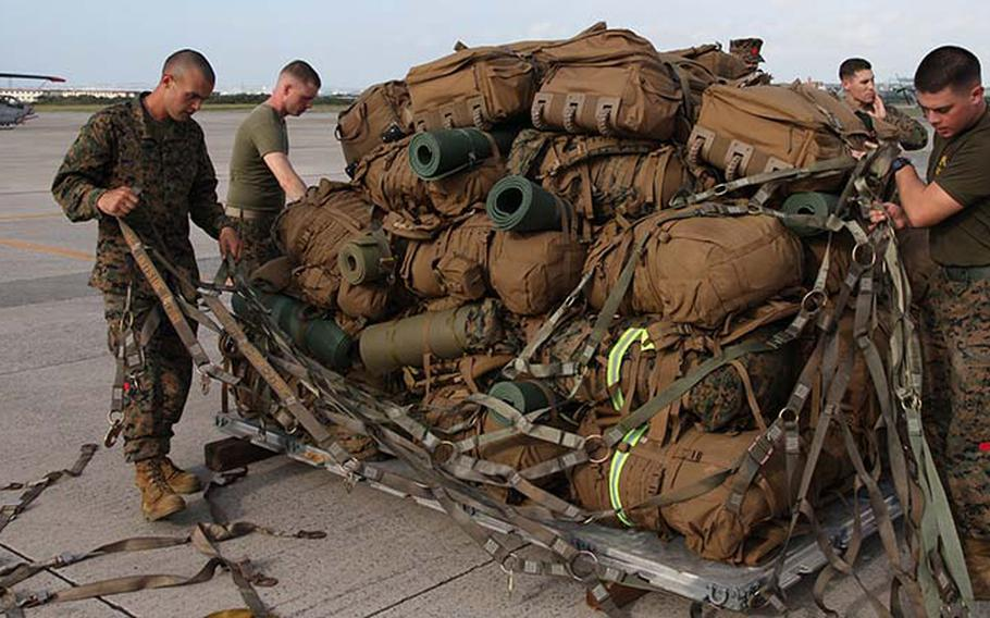 Marines secure gear onto a pallet Sunday, Nov. 10, 2013, at Marine Corps Air Station Futenma during preparation for a humanitarian assistance and disaster relief mission to the Philippines after Typhoon Haiyan.