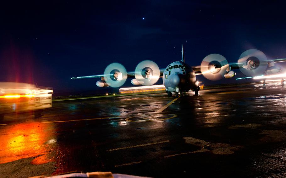An aircraft at Tacloban Airport, Philippines, waits on the runway as victims of Super Typhoon Haiyan prepare to board.