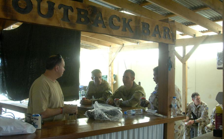 """Australian soldiers relax at the """"Outback Bar"""" at Multinational Base Tirin Kot, Afghanistan, in August 2010.  The Australian Defence Force has handed over control of the base to Afghan forces as part of its withdrawal from Afghanistan."""