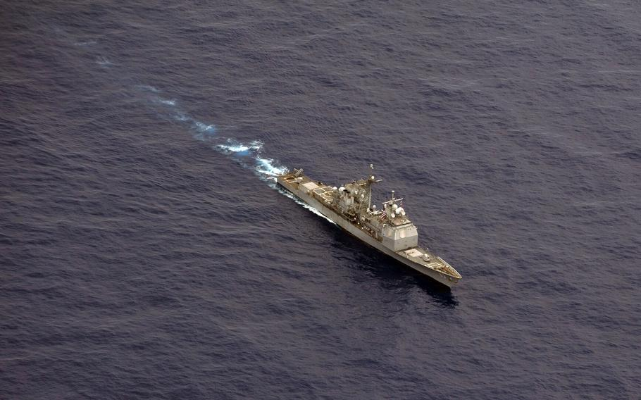 The USS Cowpens moves into position before firing missiles at a flying drone during a live fire weapons shoot in the western Pacific Ocean in this Sept. 2012 photo.
