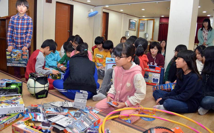 Children from Dream-Up Home orphanage select donated toys at Suwon, South Korea, on Dec. 22, 2013. Over 300 toys were donated by U.S. military personnel stationed in South Korea.