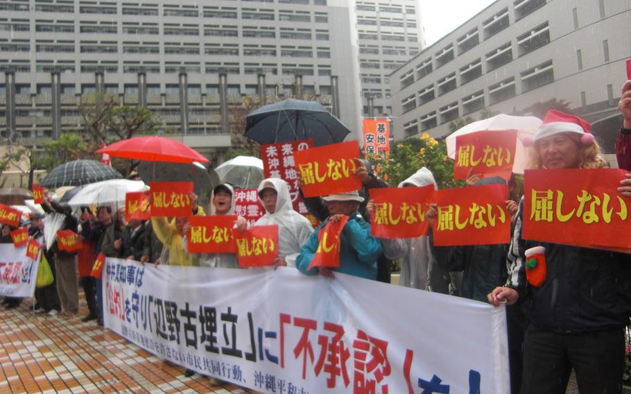 Opponents of a new Marine Corps runway project on Camp Schwab rally Tuesday to demand Gov. Hirokazu Nakaima to disapprove a request from Tokyo to reclaim waters off Henoko in Nago.