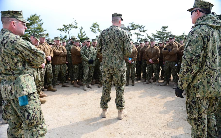 A Coast Guard port security unit listens to their commander before a land and sea exercise, all part of Foal Eagle 2013 in Pohang, South Korea, April 15, 2013.