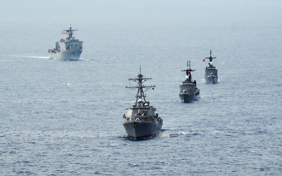 The destroyer USS John S. McCain, bottom, Philippine navy frigates BRP Gregaorio del Pilar and BRP Ramon Alcaraz and the USS Ashland are seen in formation during Cooperation Afloat Readiness and Training (CARAT) Philippines 2014 in the South China Sea on June 28, 2014.