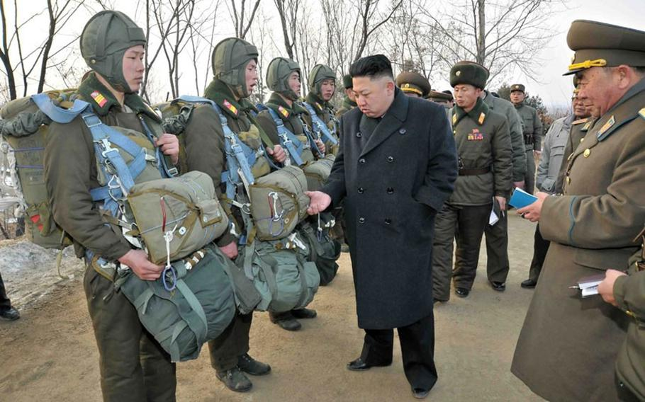 North Korean leader Kim Jong Un inspects some of his troops in this undated photo.