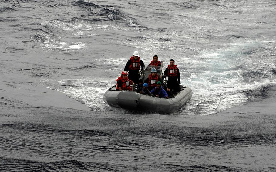 Sailors attached to the U.S. 7th Fleet flagship USS Blue Ridge speed toward a boat carrying five Philippine fishermen, who were stranded when their fishing boat suffered a mechanical problem.