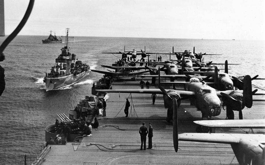 Heavily armed escorts follow the USS Hornet to protect its lethal cargo of B-25 bombers during the Doolittle Raids on the Japanese mainland April 18, 1942.