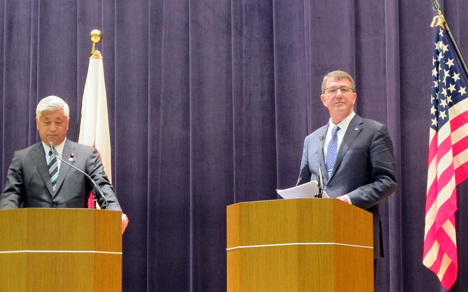 Japan Defense Minister Gen Nakatani, left, and U.S. Defense Secretary Ash Carter speak with reporters at the Japan Ministry of Defense in Tokyo on April 8, 2015. The nations are working on the final details of the 1st revision to their bilateral national defense guidelines since 1997.