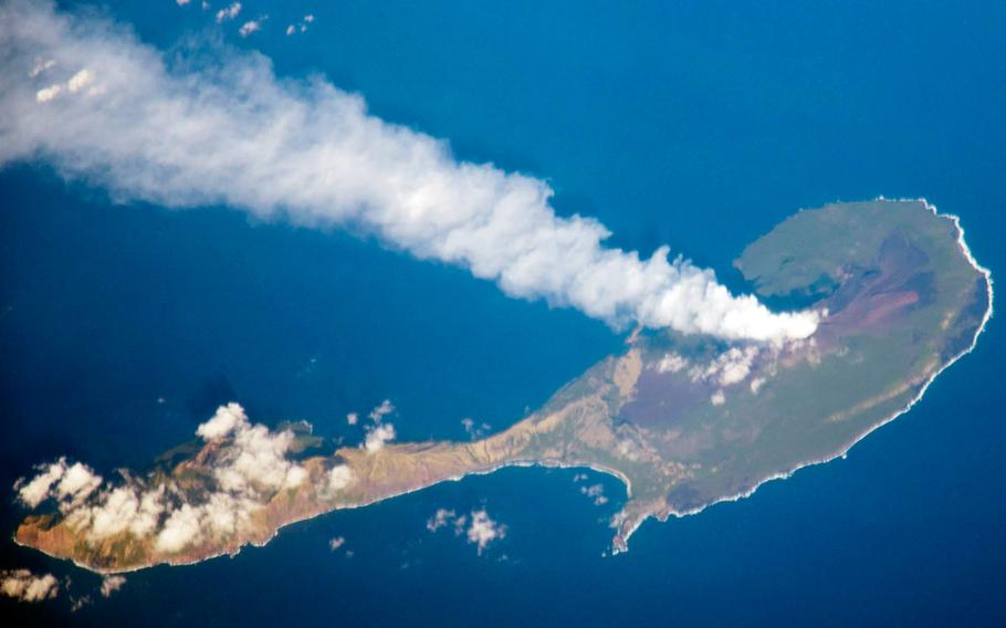 A plume rises from the volcano on the northern end of Pagan Island in this photo taken from the International Space Station on March 6, 2012.