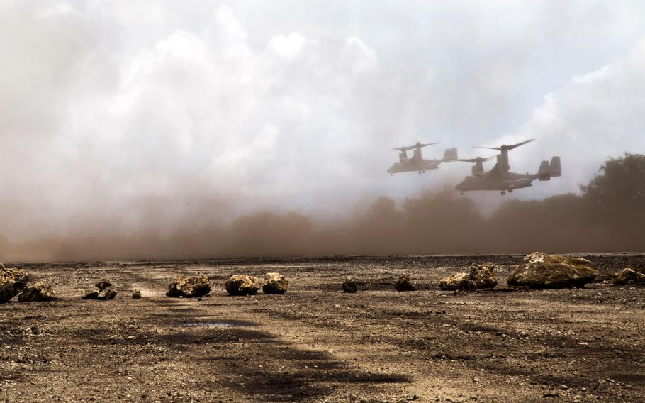 Two MV-22B Ospreys land on Echo Field in Tinian Island, in the Commonwealth of the Northern Mariana Islands, on Sept. 21, 2014, during the Valiant Shield exercise.
