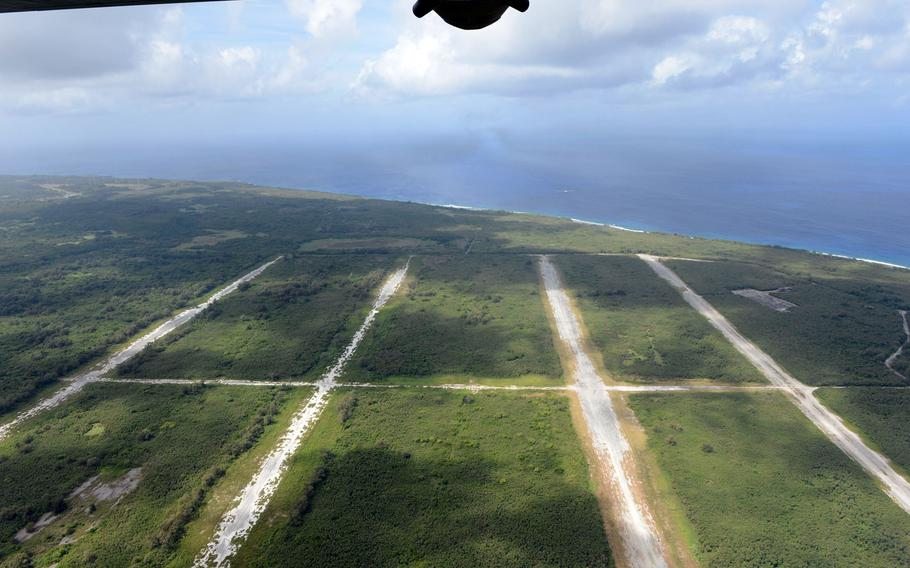 A U.S. Air Force C-130H Hercules flies over Tinian's North Field during the Cope North exercise in February 2015.