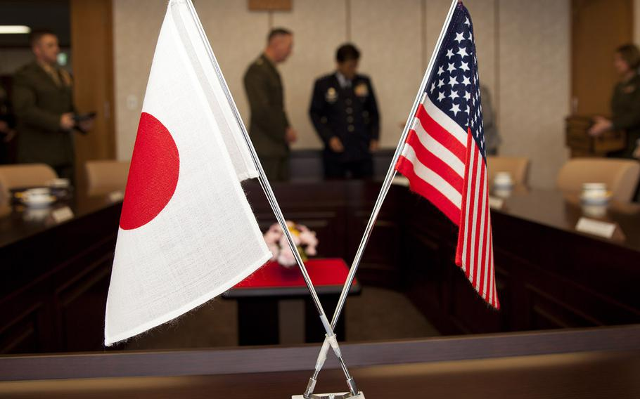 A flag display for a meeting between Commandant of the Marine Corps Gen. Joseph F. Dunford Jr. and Gen. Harukazu Saito, the chief of staff of Japan Air Self-Defense Force, at Tokyo, Japan, March 23, 2015.