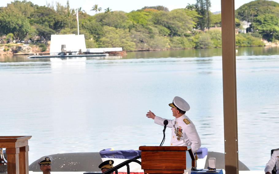 Adm. Jonathan W. Greenert, chief of naval operations, points out the backdrop of the USS Arizona Memorial for the change-of-command ceremony for fleet commander and Pacific command Wednesday, May 27, 2015, at Joint Base Pearl Harbor-Hickam, Hawaii.