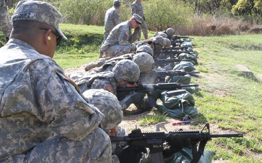 U.S. soldiers take part in the Best Warrior Competition 2015 at Masan range, South Korea, on April 14, 2015. Because of the North Korean threat and a rising China, U.S. Army units in South Korea were spared from the Army's plan to cut 40,000 active-duty troops.