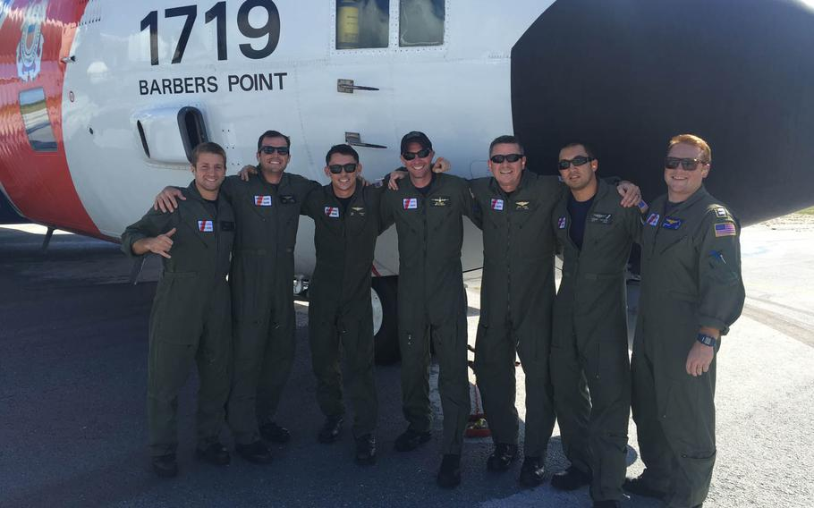 Crewmembers from Coast Guard Air Station Barbers Point out of Oahu, Hawaii, pose after assisting in the rescue Saturday, July 11, 2015, of five men who were stranded at sea near Teraina Island, Kiribati.