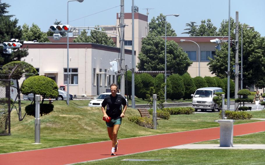 A man runs the track on Yokota Air Base in Japan on July 14, 2015. The base elevated its heat category to red recommending members of the base to limit outdoor activities to 30 minutes per hour or less.