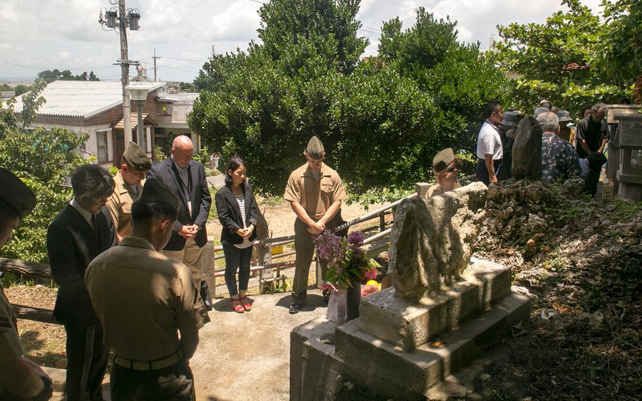 In this file photo from June 23, 2014, Marines and local community members pay respects to Col. Kermit Shelly and those who died during the Battle of Okinawa on Hamahiga Island. The contributions Shelly and his Marines made to Hamahiga were so appreciated by the community that a memorial was constructed for him and maintained following his death.