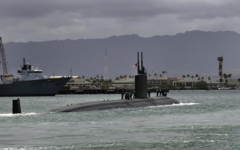 The Los Angeles-class submarine USS Tucson departs Joint Base Pearl Harbor-Hickam for a scheduled deployment to the western Pacific region in 2010. A new report by Rand Corp. said the United States should decrease its emphasis on large aircraft carriers in the Pacific and spend more on submarines.