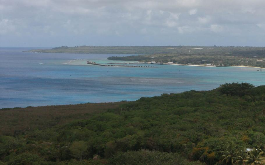 An overlook area shows the lush vegetation found on Tinian in the Commonwealth of Northern Mariana Islands near Guam. The Defense Department says it will revise an environmental study for the proposed construction of military training areas on the islands.