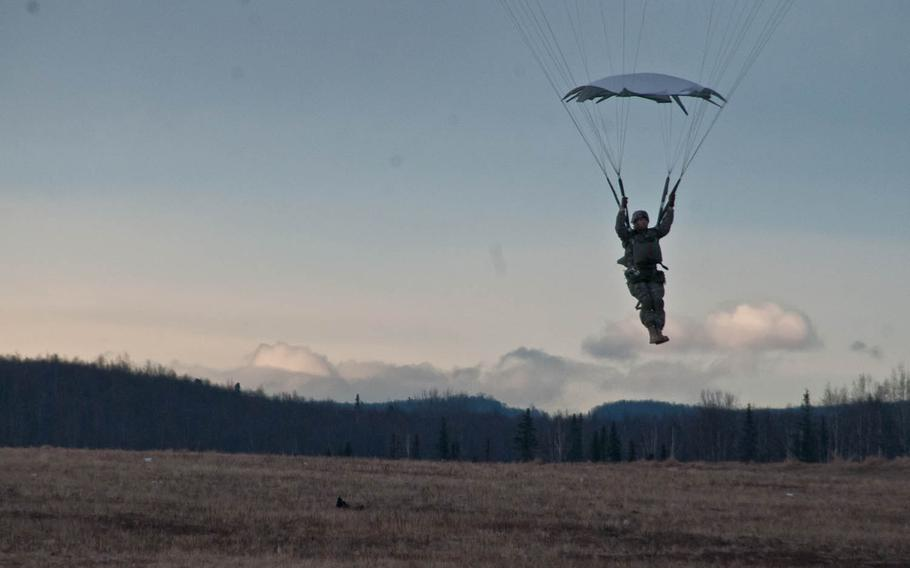 A paratrooper with U.S. Army Alaska's 4th Infantry Brigade Combat Team, 25th Infantry Division descends after performing a proficiency jump at Joint Base Elmendorf-Richardson, Alaska, March 26, 2015. Plans announced in July to cut 2,600 soldiers from the unit hae been delayed, officials said.