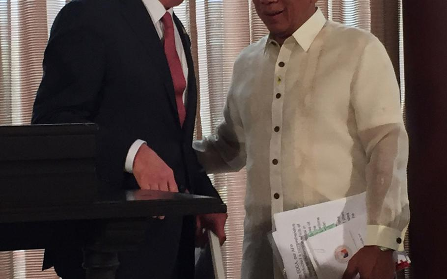 Defense Secretary Ash Carter speaks with Philippines defense minister Voltaire Gazmin after they announced on Thursday, April 14, 2016, that new rotational forces will operate out of the Philippines.