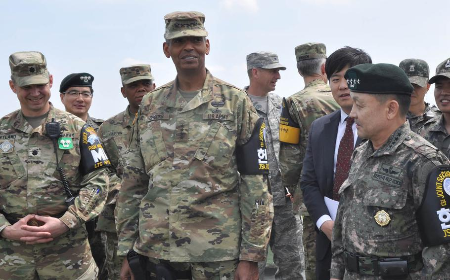 Gen. Vincent Brooks, U.S. Forces Korea commander, and Gen. Lee Soon-jim, of the South Korean joint chiefs of staff, look out at North Korea from Outpost Ouellette at the Demilitarized Zone that divides the Korean Peninsula Thursday, May 12, 2016. The U.S. and South Korea will be joined by Japanese forces next month in an anti-missile exercise aimed at countering any potential missile launches from North Korea.