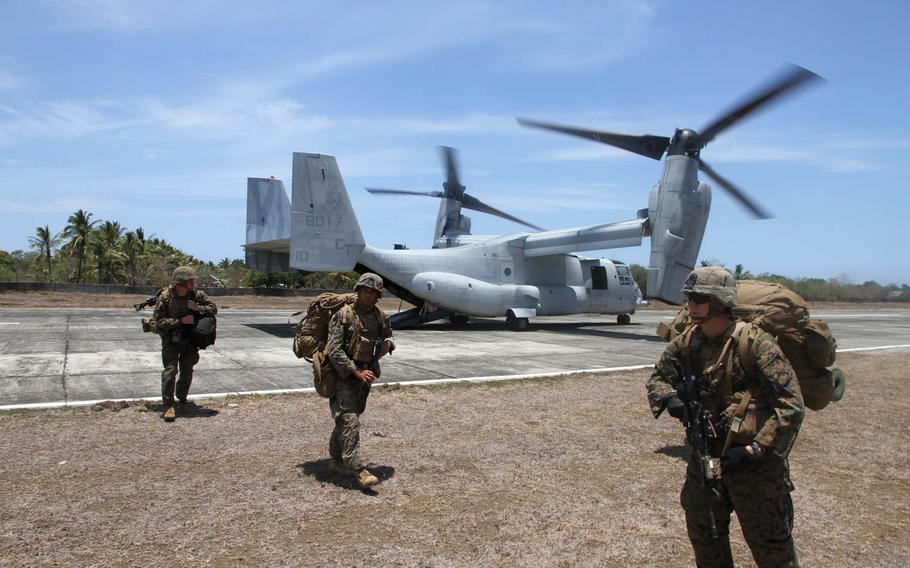 U.S. Marines disembark from an MV-22 Osprey after landing at an airstrip in Panay, Philippines, on April 11, 2016. Despite vocal opposition from Philippine President Roberto Duterte, U.S. and Philippine special forces were to begin annual combat exercises on Wednesday, Nov. 16, 2016.