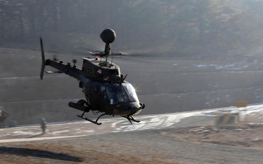 A OH-58 Kiowa helicopter takes off and flies toward a Rodriguez Live Fire Range, South Korea, Wednesday, Jan. 25, 2017. The exercise was the final time the OH-58 Kiowa was used by the Army before being decommissioned from active use.
