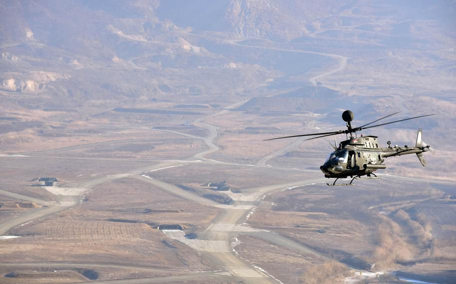 An OH-58 Kiowa helicopter performs manuevers over Rodriguez Live Fire Range, South Korea, Wednesday, Jan. 25, 2018. The exercise was the final time the OH-58 Kiowa was used by the Army as it transitions the AH-64 Apache.