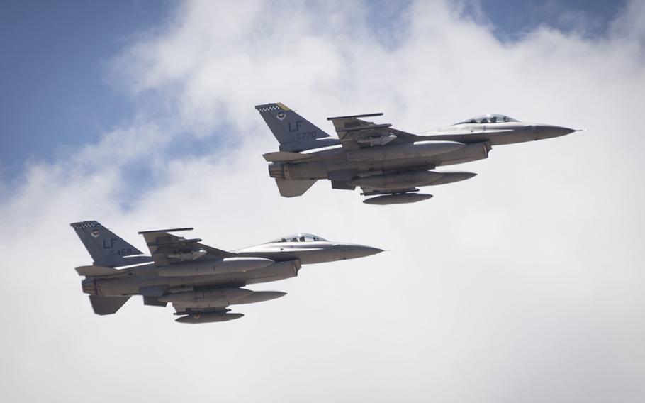 Two F-16 Fighting Falcons depart from Luke Air Force Base, Ariz. on their way to their new homes at Holloman Air Force Base, N.M., June 16, 2015.