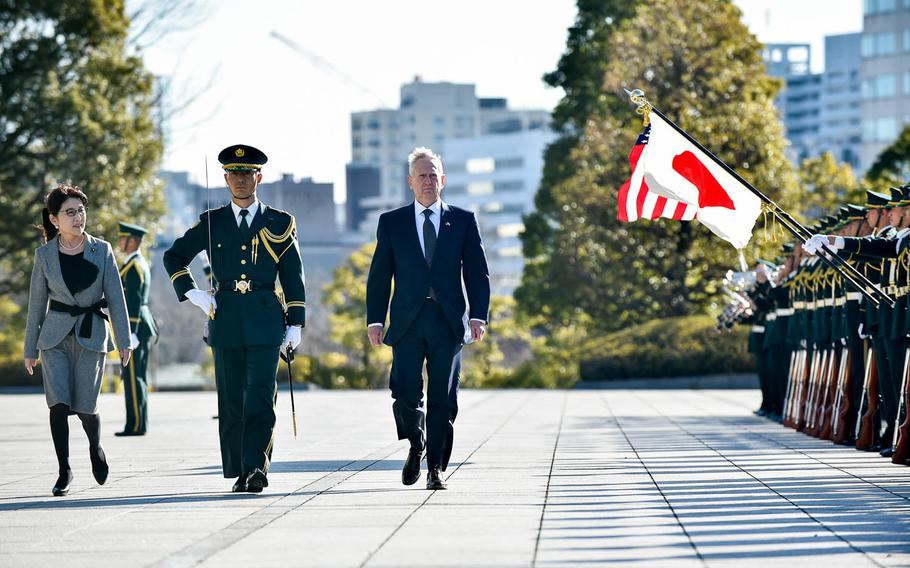 Defense Secretary Jim Mattis walks with Japanese Minister of Defense Tomomi Inada during a pass and review at the Defense Ministry in Tokyo, Saturday, Feb. 4, 2017.