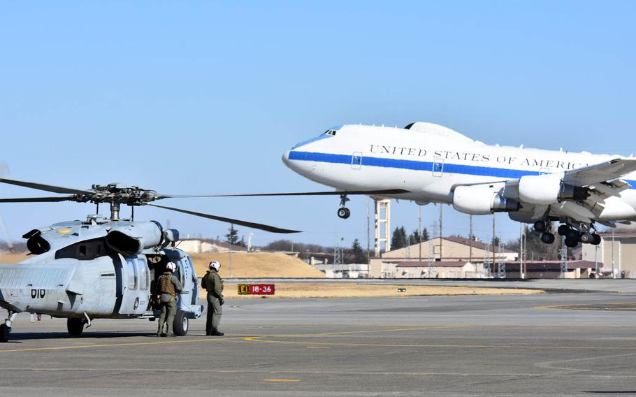A plane carrying Secretary of Defense Jim Mattis lands at Yokota Air Base, Japan, Friday, Feb. 3, 2017. It's Mattis' first visit to Japan as Pentagon chief.