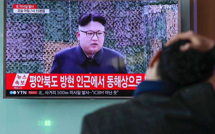 A man in Seoul, South Korea, watches a TV screen showing an image of North Korean leader Kim Jong Un during a news broadcast on Feb. 12, 2017.