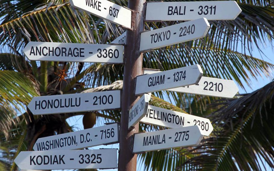 A signpost on Kwajalein Island, a tiny island in the Pacific Ocean, reminds residents that they are a long, long way from the rest of the world.