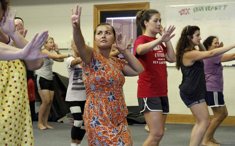 Riza Walker, second from left, dances during a hula class on Kwajalein Island.