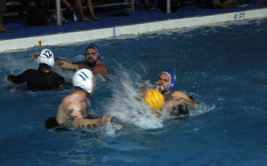 Polo Loco takes on Tyler's Angels during an evening game of water polo, one of a plethora of organized events that keep residents of the tiny island of Kwajalein busy.