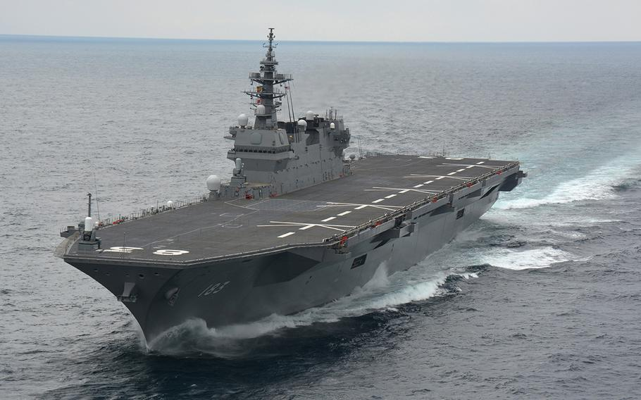 China responded cautiously to reports that the helicopter destroyer JS Izumo, shown here in an undated photo, may transit the South China Sea in May.