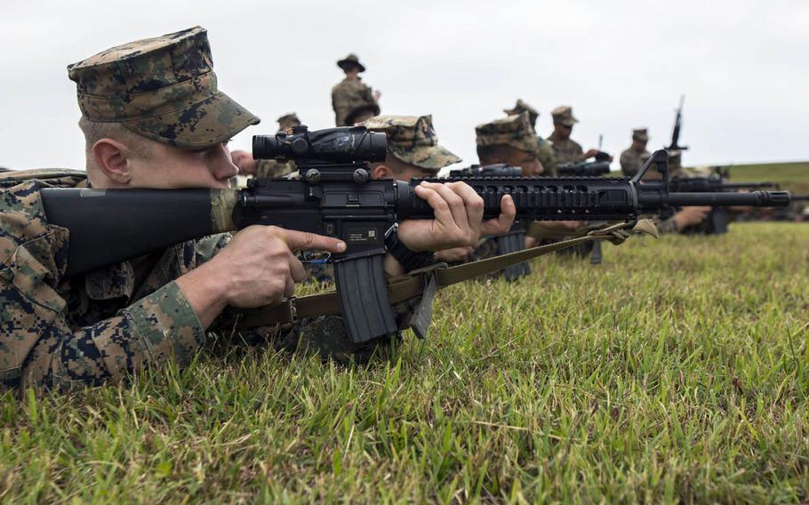 Marines participate in the Competition in Arms Program last year at Camp Hansen, Okinawa, Japan.