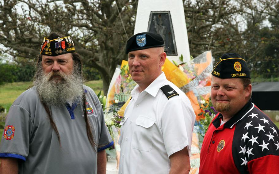 Army Col. Derek Jansen, 10th Regional Support Group commander, center, poses with members of Okinawa's American Legion Post 28 and Veterans of Foreign Wars Post 9723 at the memorial for acclaimed World War II correspondent Ernie Pyle on Ie Shima, Japan, on Sunday, April 16, 2017.
