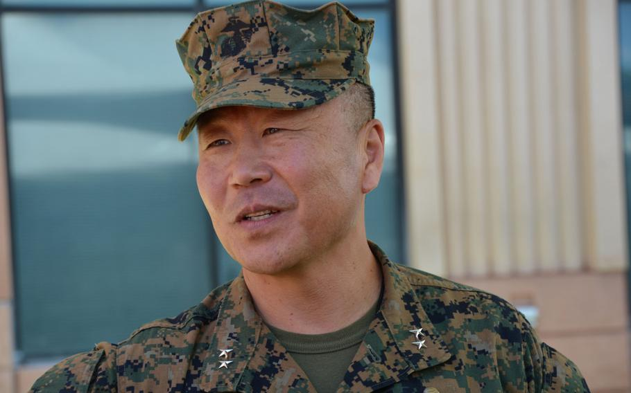 Maj. Gen. Daniel Yoo speaks with a well-wisher after taking command of Pacific Special Operations during a ceremony at Camp H.M. Smith, Hawaii, Friday, May 12, 2017.