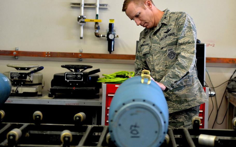 Col. Case Cunningham performs maintenance on an inert GBU-12 Paveway II laser-guided bomb in 2016 at Creech Air Force Base, Nevada. Cunningham has been selected to lead the 18th Wing at Kadena Air Base, Japan, and for promotion to brigadier general.