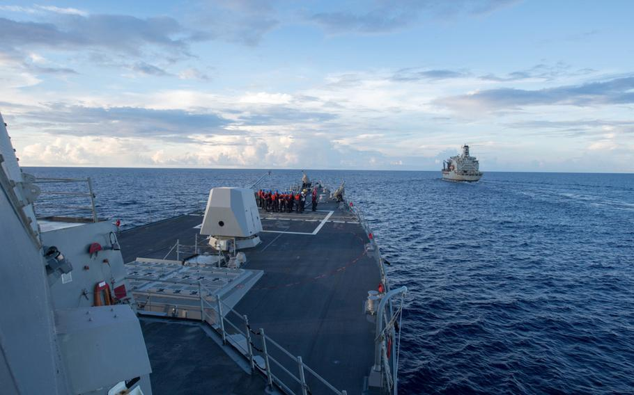 The destroyer USS Dewey shown here during a supply replenishment on May 19 in the South China Sea, sailed within 12 nautical miles of Mischief Reef, a China-occupied territory, as part of the first freedom-of-navigation operation undertaken under the Trump administration.