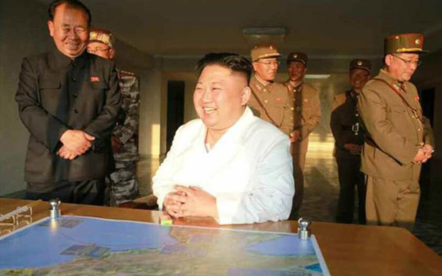 North Korean leader Kim Jong Un shown observing missile test in photos published May 30, 2017, in Rodong Sinmun, the official organ of the ruling Workers' Party. The photos did not include a caption but accompanied a story about a launch the day before of a reported short-range missile.